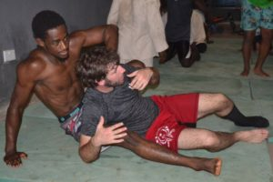 African martial artist practices BJJ nogi technique during MMA seminar in support of the mma4africa movement in The Gambia